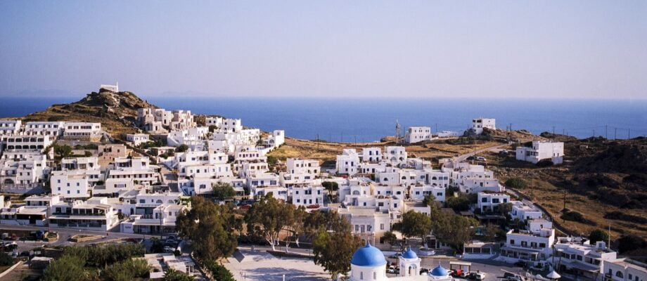View of whitewashed buildings with blue roofs on Ios in the Greek Islands